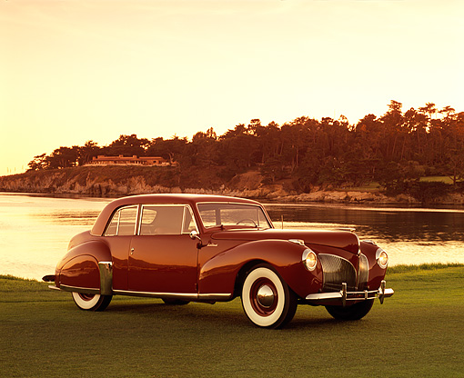 AUT 20 RK0256 05 © Kimball Stock 1941 Lincoln Continental Coupe Red 3/4 Side View On Grass By Water