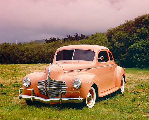 AUT 20 RK0271 03 © Kimball Stock 1940 Dodge Business Coupe Peach 3/4 Front View On Grass Filtered