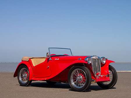 AUT 20 RK0296 01 © Kimball Stock 1948 MG TC Red Convertible Red 3/4 Front View On Pavement