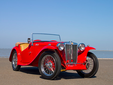 AUT 20 RK0297 01 © Kimball Stock 1948 MG TC Red Convertible Red Low 3/4 Front View On Pavement