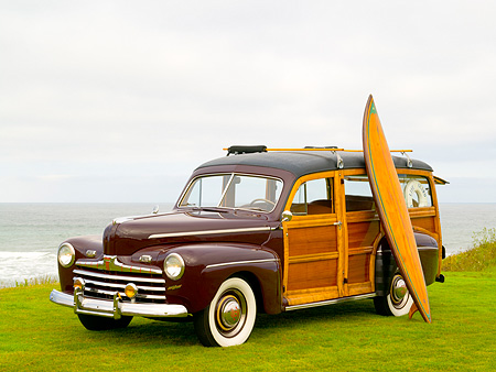 AUT 20 RK0300 01 © Kimball Stock 1946 Ford Woody Station Wagon Maroon 3/4 Front View On Grass