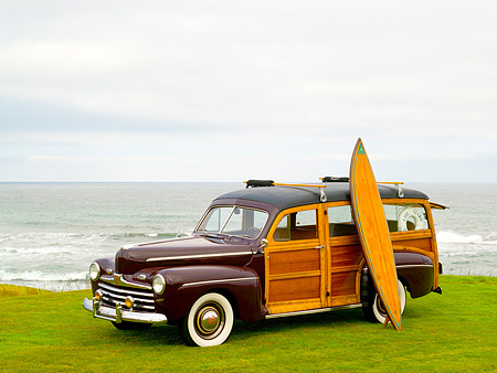 AUT 20 RK0301 01 © Kimball Stock 1946 Ford Woody Station Wagon Maroon 3/4 Side View On Grass
