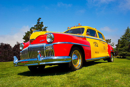 AUT 20 RK0305 01 © Kimball Stock 1946 De Soto Taxi Cab Red And Yellow Low 3/4 Front View On Grass