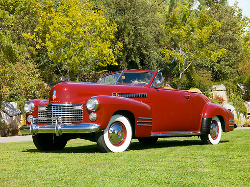 AUT 20 RK0323 01 © Kimball Stock 1941 Cadillac Deluxe Convertible Coupe Oxblood Red Front 3/4 View On Grass By Trees