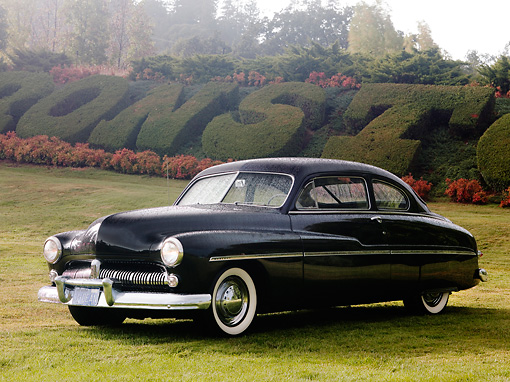 AUT 20 RK0333 01 © Kimball Stock 1949 Mercury 2-Door Sedan Black 3/4 Front View On Grass By Shrubs And Trees