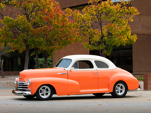 AUT 20 RK0340 01 © Kimball Stock 1948 Chevrolet Fleetmaster Coupe Salmon & Cream 3/4 Front View On Pavement