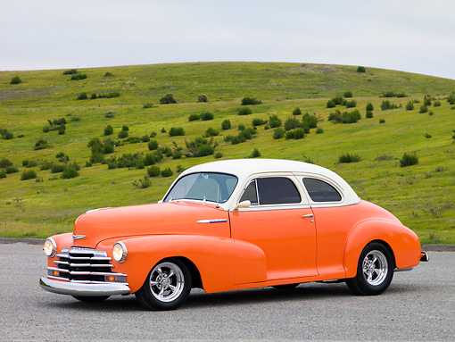 AUT 20 RK0343 01 © Kimball Stock 1948 Chevrolet Fleetmaster Coupe Salmon & Cream 3/4 Front View On Pavement