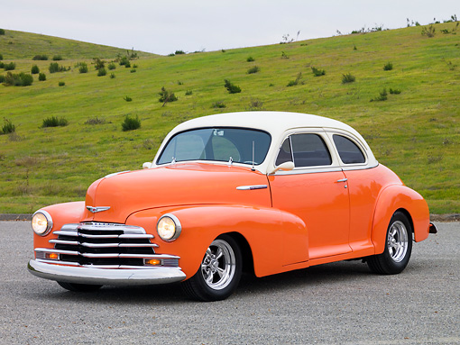 AUT 20 RK0344 01 © Kimball Stock 1948 Chevrolet Fleetmaster Coupe Salmon & Cream 3/4 Front View On Pavement