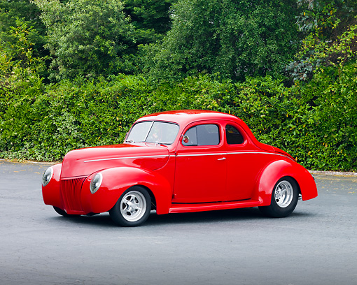 AUT 20 RK0345 01 © Kimball Stock 1940 Ford Standard Coupe Red 3/4 Front View By Shrubs