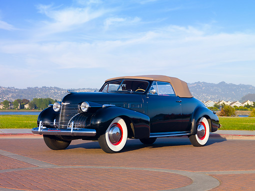 AUT 20 RK0347 01 © Kimball Stock 1940 Cadillac Convertible Black 3/4 Front View By Water