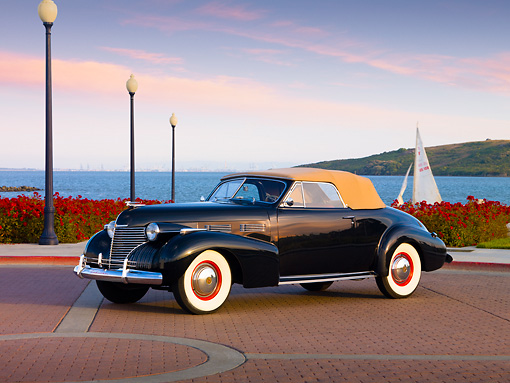 AUT 20 RK0349 01 © Kimball Stock 1940 Cadillac Convertible Black 3/4 Front View By Water