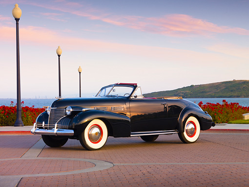 AUT 20 RK0352 01 © Kimball Stock 1940 Cadillac Convertible Black 3/4 Front View By Water