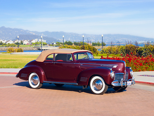AUT 20 RK0354 01 © Kimball Stock 1941 Hudson Commodore 8 Convertible Maroon 3/4 Front View By Water