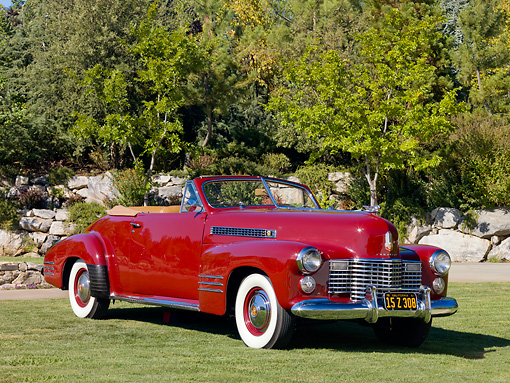 AUT 20 RK0358 01 © Kimball Stock 1941 Cadillac Deluxe Convertible Oxblood Red 3/4 Front View On Grass By Trees