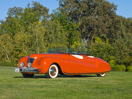 AUT 20 RK0359 01 © Kimball Stock 1941 Chrysler Newport Dual Cowl Phaeton Red 3/4 Front View On Grass By Trees