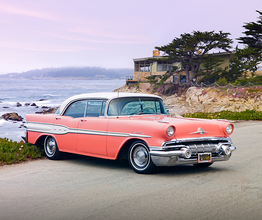 AUT 21 BK0016 01 © Kimball Stock 1957 Pontiac Chieftain Coral And White 3/4 Front View On Pavement By Ocean