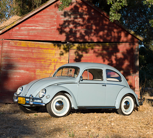 AUT 21 BK0030 01 © Kimball Stock 1957 Volkswagen Beetle Light Blue 3/4 Side View On Dirt By Barn