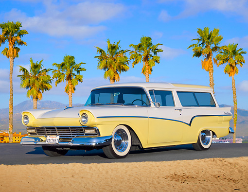 AUT 21 BK0052 01 © Kimball Stock 1957 Ford Del Rio Ranch Wagon Yellow And White 3/4 Front View On Pavement By Palm Trees