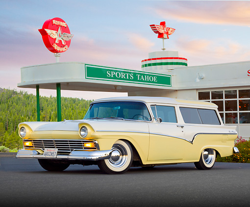 AUT 21 BK0053 01 © Kimball Stock 1957 Ford Del Rio Ranch Wagon Yellow And White 3/4 Front View On Pavement By Gas Station