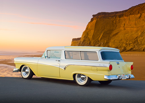 AUT 21 BK0056 01 © Kimball Stock 1957 Ford Del Rio Ranch Wagon Yellow And White 3/4 Rear View On Pavement By Beach