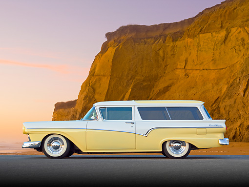 AUT 21 BK0057 01 © Kimball Stock 1957 Ford Del Rio Ranch Wagon Yellow And White Profile View On Pavement By Beach