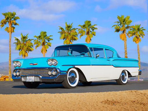 AUT 21 BK0058 01 © Kimball Stock 1958 Chevrolet Delray Turquoise And White 3/4 Front View On Pavement By Palm Trees And Sand