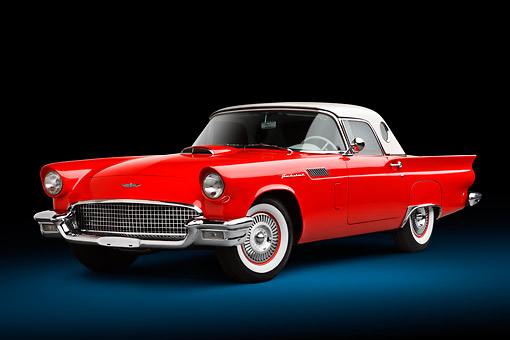 AUT 21 BK0125 01 © Kimball Stock 1957 Ford Thunderbird Red With White Top 3/4 Front View In Studio