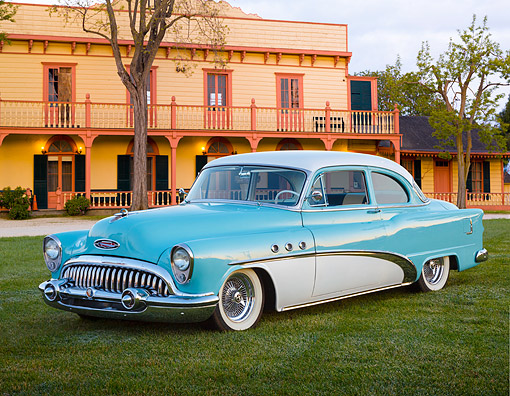 AUT 21 BK0126 01 © Kimball Stock 1953 Buick Special Blue And White 3/4 Front View On Grass By Building