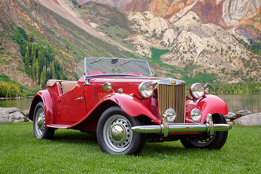 AUT 21 BK0135 01 © Kimball Stock 1953 MG TD Red 3/4 Front View By Mountain Lake