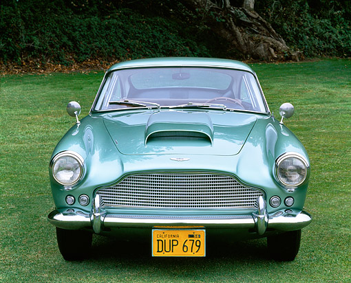 AUT 21 RK0091 08 © Kimball Stock 1959 Aston Martin DB4 Series One Light Green Head On Shot On Grass