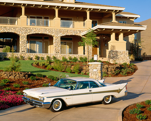 AUT 21 RK0100 12 © Kimball Stock 1959 White DeSoto Adventurer Overhead 3/4 Side On Driveway In Front Of House Blue Sky