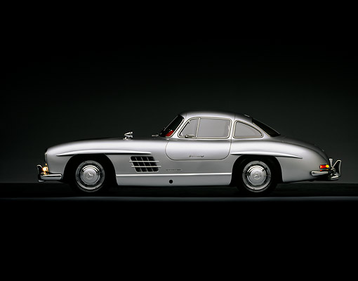 AUT 21 RK0116 01 © Kimball Stock 1956 Mercedes-Benz 300SL Gullwing Silver Profile On Gray Line Studio