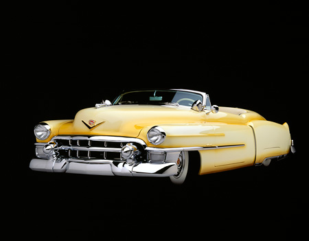 AUT 21 RK0152 08 © Kimball Stock 1953 Cadillac Eldorado Convertible Yellow Top Down 3/4 Low Front Studio Background
