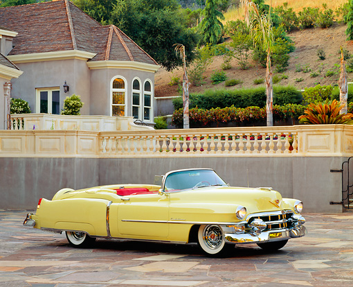 AUT 21 RK0248 01 © Kimball Stock 1953 Yellow Cadillac Eldorado Convertible 3/4 Side On Pavement By House Headlights On