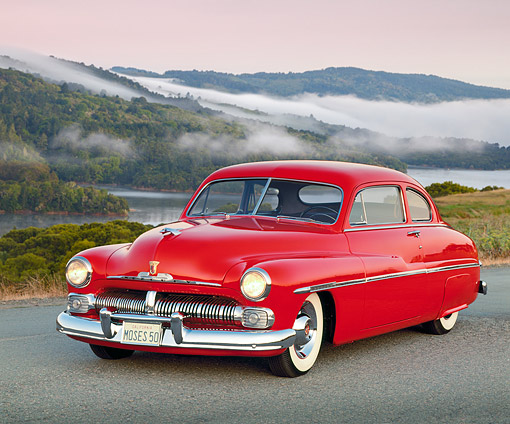 AUT 21 RK0324 01 © Kimball Stock 1950 Red Mercury 3/4 Front View On Pavement By Lake At Dusk