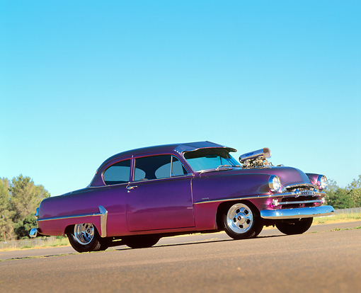 AUT 21 RK0457 01 © Kimball Stock 1954 Plymouth Savoy Purple Slanted 3/4 Side View On Pavement