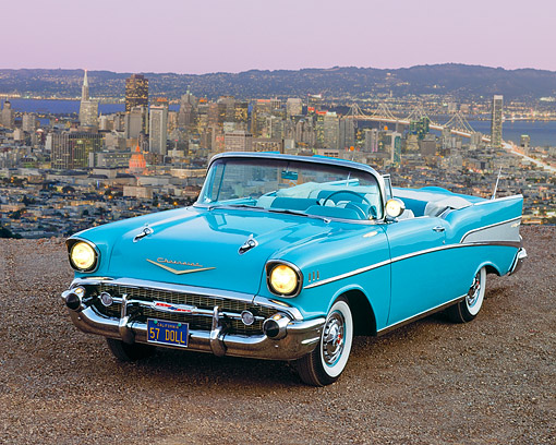 AUT 21 RK0600 04 © Kimball Stock 1957 Chevrolet Bel Air Convertible Light Blue 3/4 Front View On Dirt Overlooking City