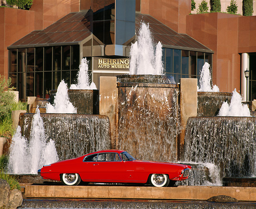AUT 21 RK0702 08 © Kimball Stock 1954 De Soto Adventure Coupe Red Profile View By Waterfall