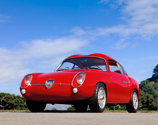 AUT 21 RK0784 01 © Kimball Stock 1959 Abarth Zagato Double Bubble Coupe Red Low 3/4 Front View On Pavement Blue Sky