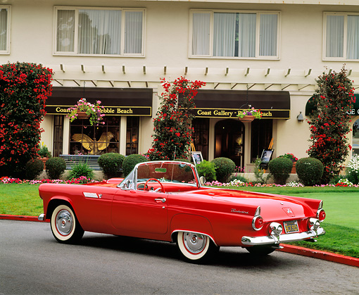 AUT 21 RK1082 01 © Kimball Stock 1955 Ford Thunderbird Convertible Red 3/4 Rear View On Pavement By Building