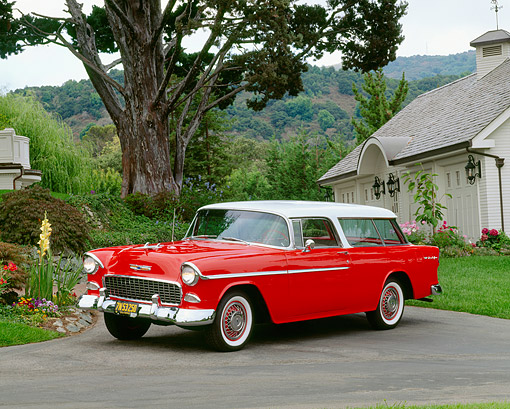 AUT 21 RK1097 01 © Kimball Stock 1955 Chevy Nomad Wagon Red White Top 3/4 Front View On Pavement By Flowers And Trees