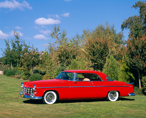 AUT 21 RK1138 01 © Kimball Stock 1955 Chrysler C-300 Red 3/4 Side View On Grass By Trees Blue Sky