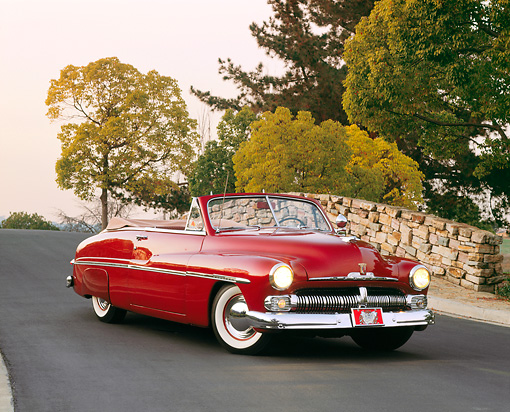 AUT 21 RK1169 04 © Kimball Stock 1950 Mercury Convertible Dark Red 3/4 Front View On Pavement By Stone Bridge And Trees
