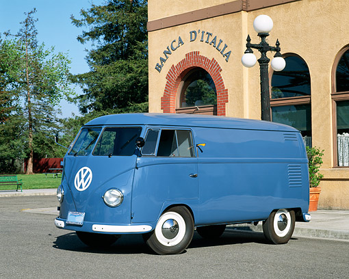 AUT 21 RK1274 02 © Kimball Stock 1955 VW Barn Door Panel Bus Blue 3/4 Front View On Pavement By Building