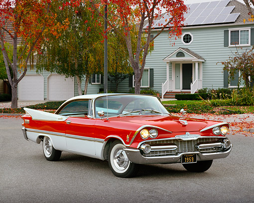 AUT 21 RK1323 04 © Kimball Stock 1959 Dodge Royal Hardtop Red And White 3/4 Front View On Pavement By House