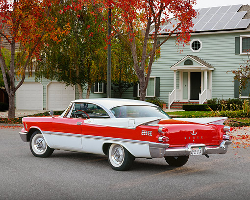 AUT 21 RK1326 02 © Kimball Stock 1959 Dodge Royal Hardtop Red And White 3/4 Rear View On Pavement By House