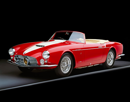 AUT 21 RK1338 07 © Kimball Stock 1957 Maserati A6G/2000 Frua Spider Red With White Stripe Front 3/4 View On Gray Line Studio