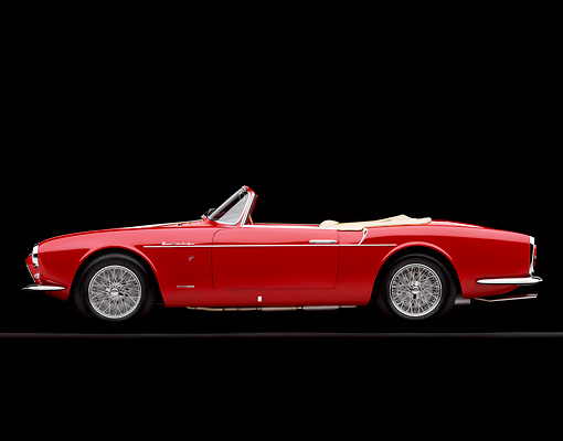 AUT 21 RK1339 03 © Kimball Stock 1957 Maserati A6G/2000 Frua Spider Red With White Stripe Side View On Gray Line Studio