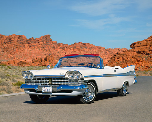 AUT 21 RK1422 02 © Kimball Stock 1959 Plymouth Sport Fury Convertible White Low 3/4 Front View On Pavement By Red Rock