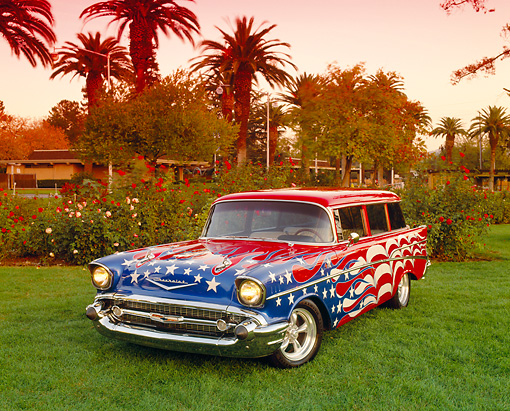 AUT 21 RK1469 01 © Kimball Stock 1957 Chevy 210 Wagon American Graphics 3/4 Front View On Grass By Trees Filtered